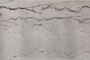 Comment réparer les fissures dans Stuc Avant Peinture