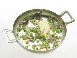 Comment puis-je nettoyer brûlé la nourriture d'un acier inoxydable Pan?
